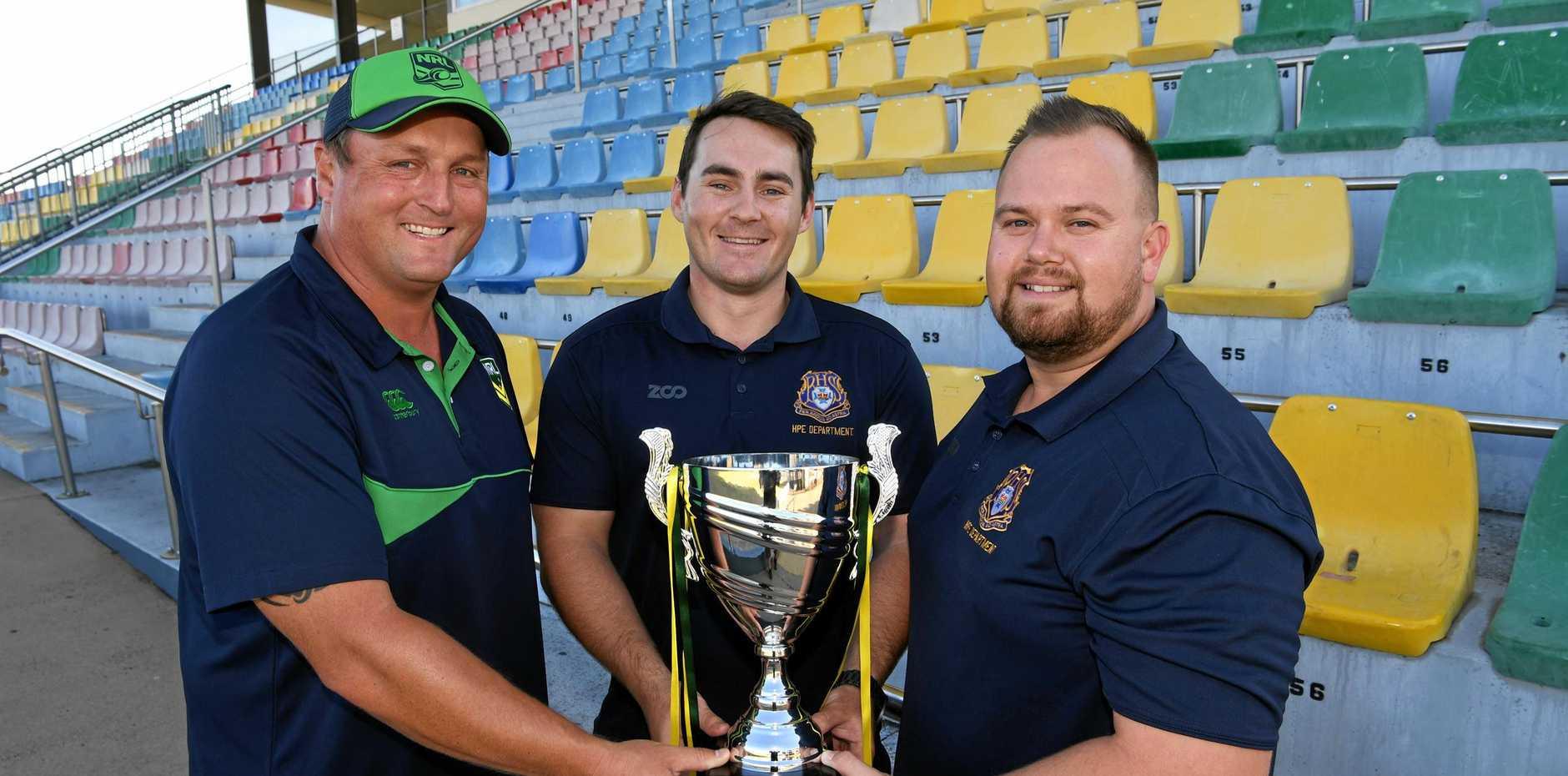 Ian Kearton presents Kevin Sherriff and Mark Handley with the Schoolboy Trophy.