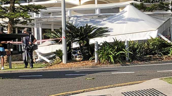 DAMAGE: A vehicle ploughed into cracked pepper Mooloolaba on Saturday moring during breakfast period.