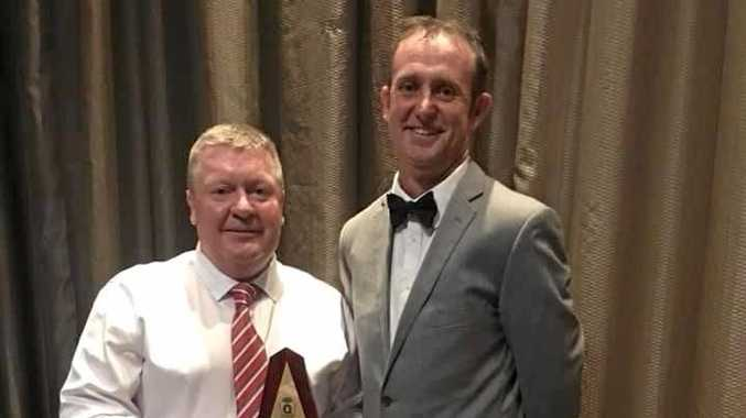 HUGE ACCOLADE: AFL Capricornia Competition and Club Development Manager Brad Matheson presents Andrew McMahon with the award.