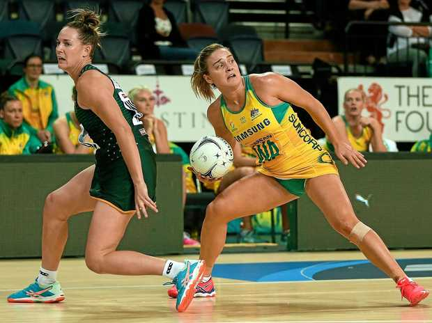 Liz Watson of the Diamonds outmanoeuvres her South African opponent during the Quad Series opener in Auckland on Saturday. Picture: David Rowland/AAP