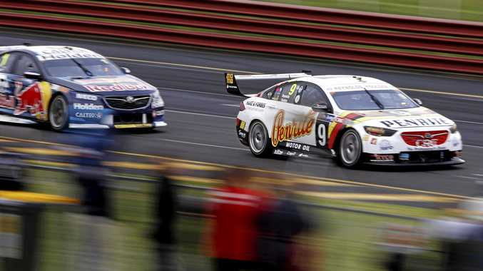 David Reynolds leads Jamie Whincup in the Red Bull Holden Racing Team Holden Commodore ZB during qualifying for the Sandown 500. Picture: Daniel Pockett/AAP