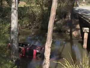 Man charged over woman's death in creek crash