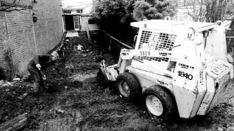 Forensic police in the rear garden of 25 Cromwell St on March 7, 1994. By this point, seven bodies had already been found and Fred West had committed suicide.