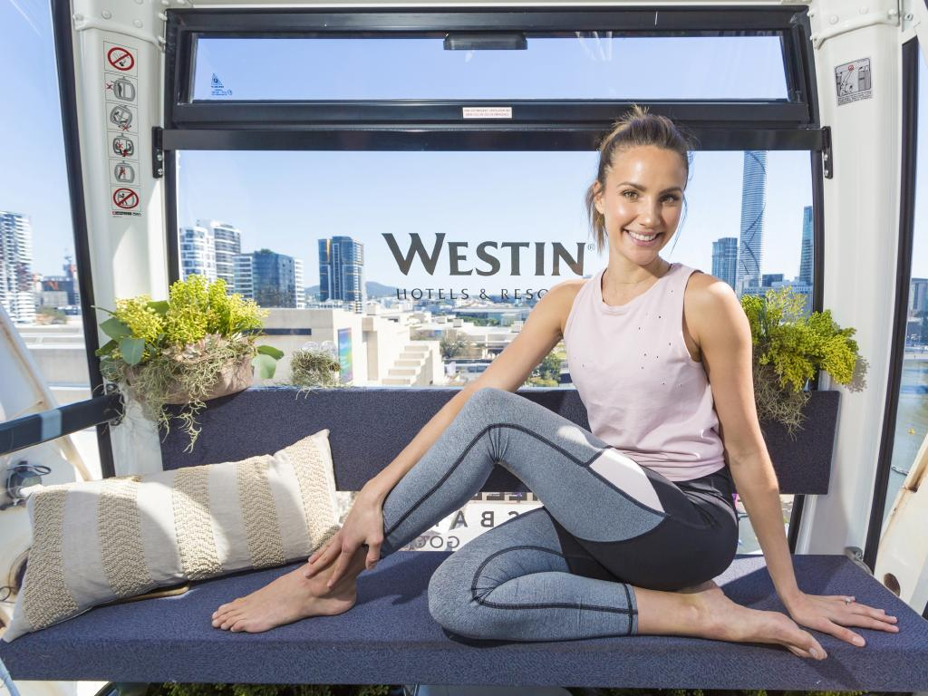 Westin wellbeing ambassador Rachael Finch in the hotel chain's gondola on the wheel of Brisbane today. Picture: Sarah Keayes/The Photo Pitch