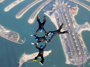 Skydiver gets blown off track and lands in street