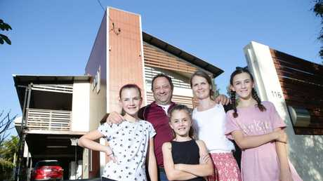 Matt and Mirjam MacGregor with their daughters Leah 11, Hannah 9 and Hayley 13 at their home in Aspley 14th September 2018. The family moved from Norway to Woollongong and then to Brisbane, where they plan to stay forever. Photo AAP/ Ric Frearson