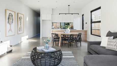 203A Gooch St, Thornbury presents a smartly-styled and clutter-free interior, and is for sale with a $980,000-$1.05m price guide.