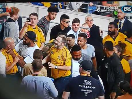 Wallabies players clash with fans