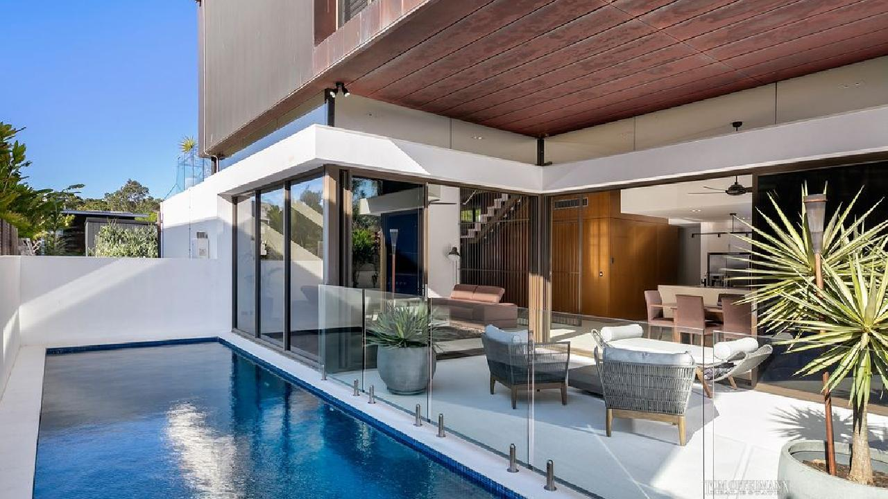Tom Offerman Real Estate has the listing for this house at 8 Cottonwood Ct, Noosa Heads