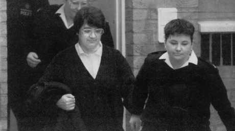 A photo of serial killer Rosemary West being escorted by prison guards from Brian West's 1996 book 'She Must Have Known'.