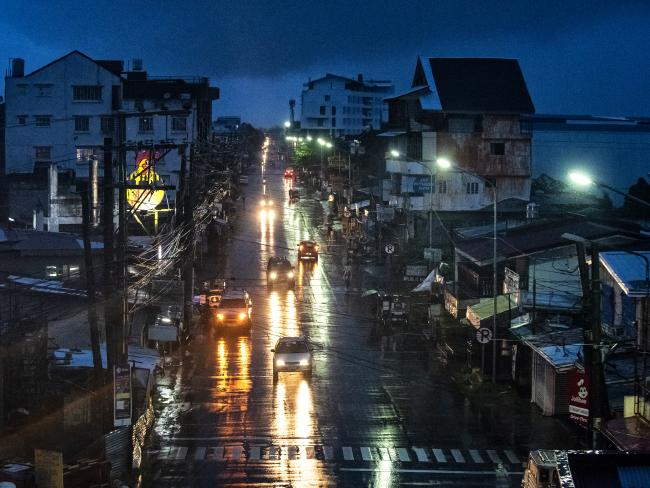 Rain covers the city lying on the path of Typhoon Mangkhut as residents prepare its approach on September 14. Picture: Jes Aznar
