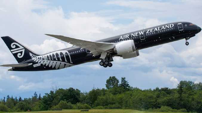 An Air New Zealand passenger has had his conviction quashed after he accused parents of 'torturing' their child on a flight from Melbourne to Wellington.
