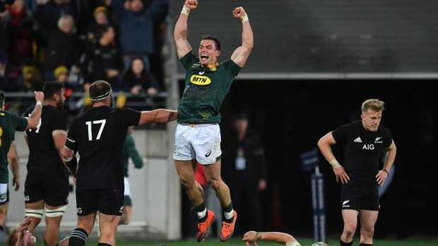 South Africa's Jesse Kriel (C) celebrates victory during the Rugby Championship match between the New Zealand All Blacks and South Africa at Westpac Stadium in Wellington on September 15, 2018. (Photo by Marty MELVILLE / AFP)
