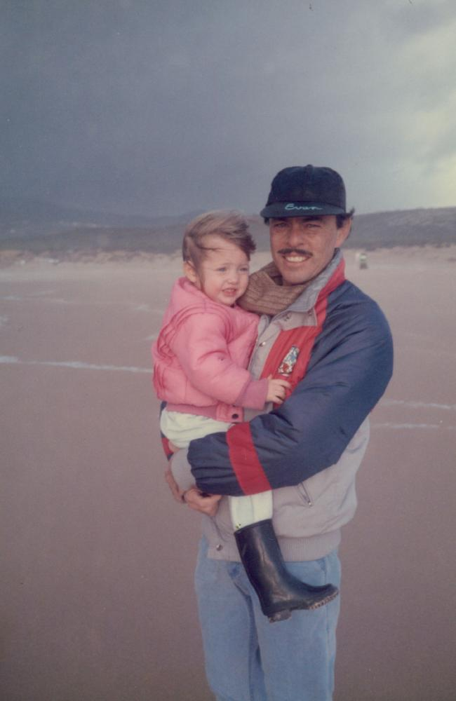 Dad and daughter on a beach in Portugal.