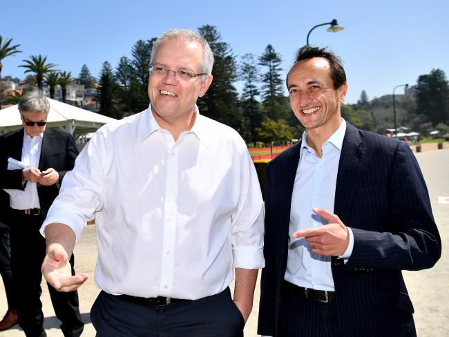 Prime Minister Scott Morrison and Liberal Party candidate for Wentworth Dave Sharma during a visit to Bronte Beach in Sydney on Friday. Picture: AAP Image/Joel Carrett