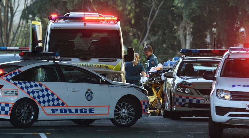 A police incident at the Ipswich Train Station on Sunday afternoon. Paramedics take a person to a waiting ambulance.