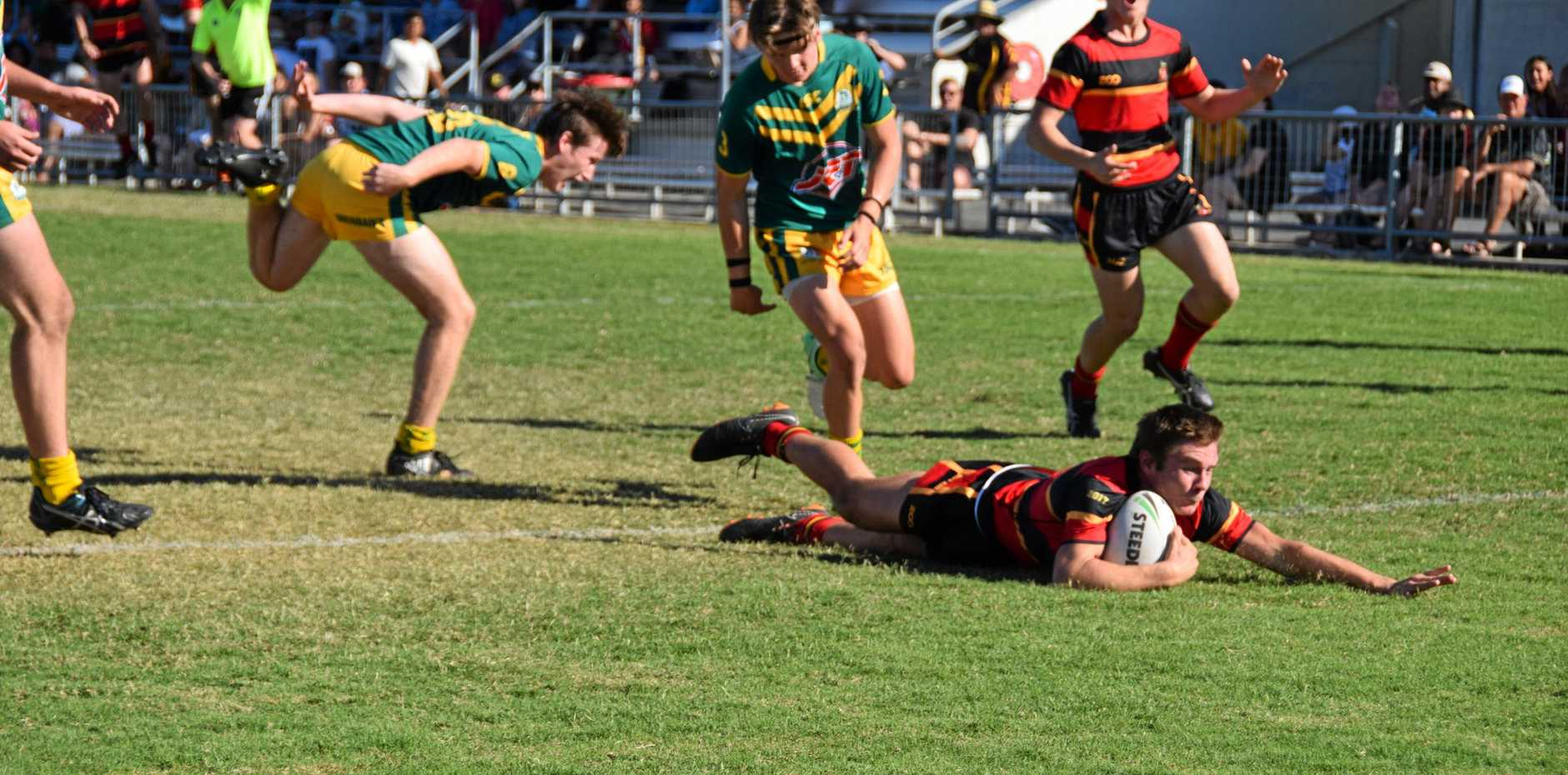 Rockhampton Grammar's Jacob Spark goes in for a try.
