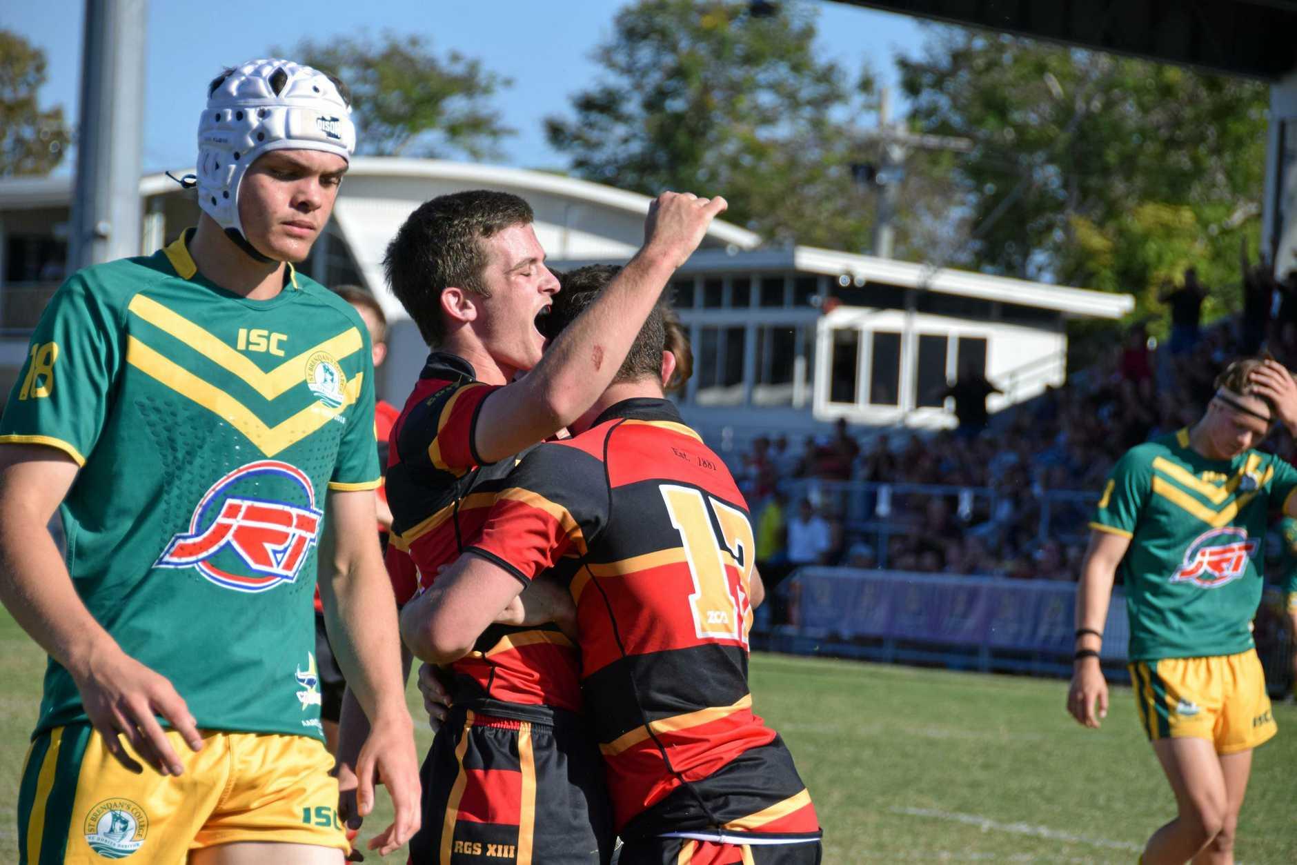 Rockhampton Grammar c0-captain Aaron Moore celebrates his team's thrilling victory.