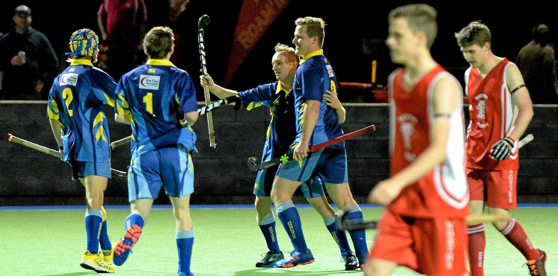 Hancocks players celebrate Ryan Smith's opening goal in Saturday night's Ipswich A-Grade hockey grand final victory over Norths.