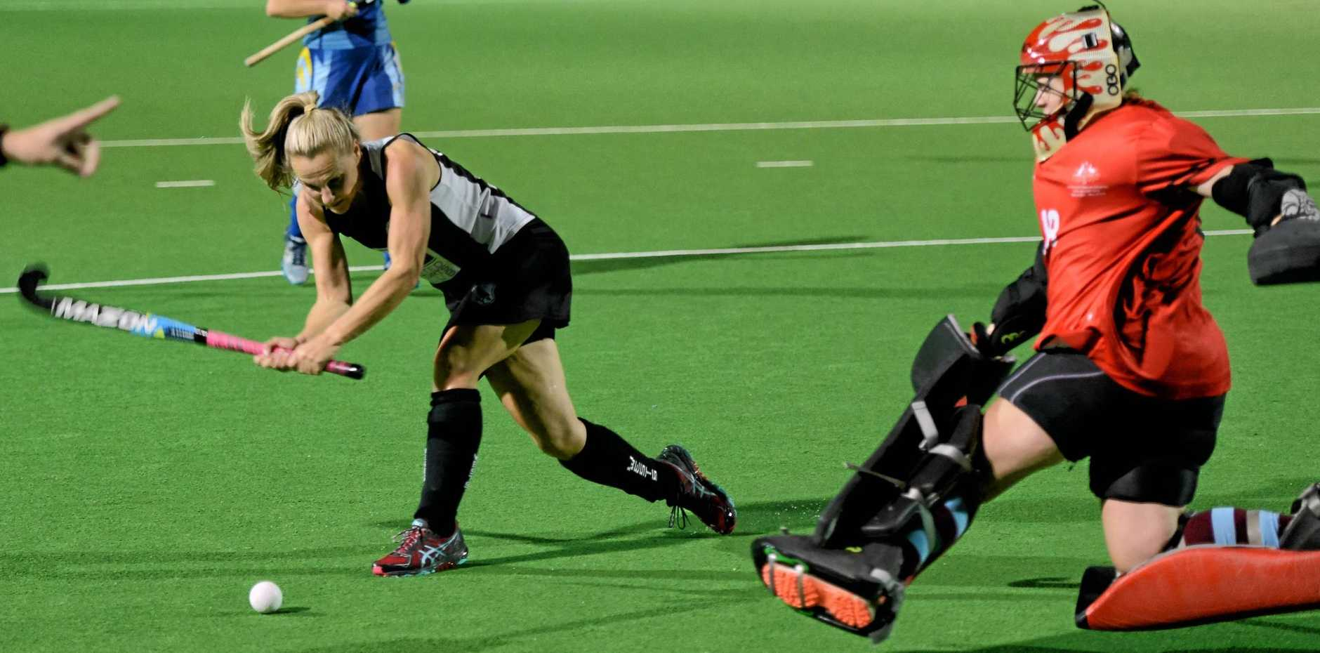 Hancocks goalkeeper and player of the final Shahna Hamment faces another mighty challenge from former international striker Amy Kickbusch in Saturday night's Ipswich A-Grade grand final.