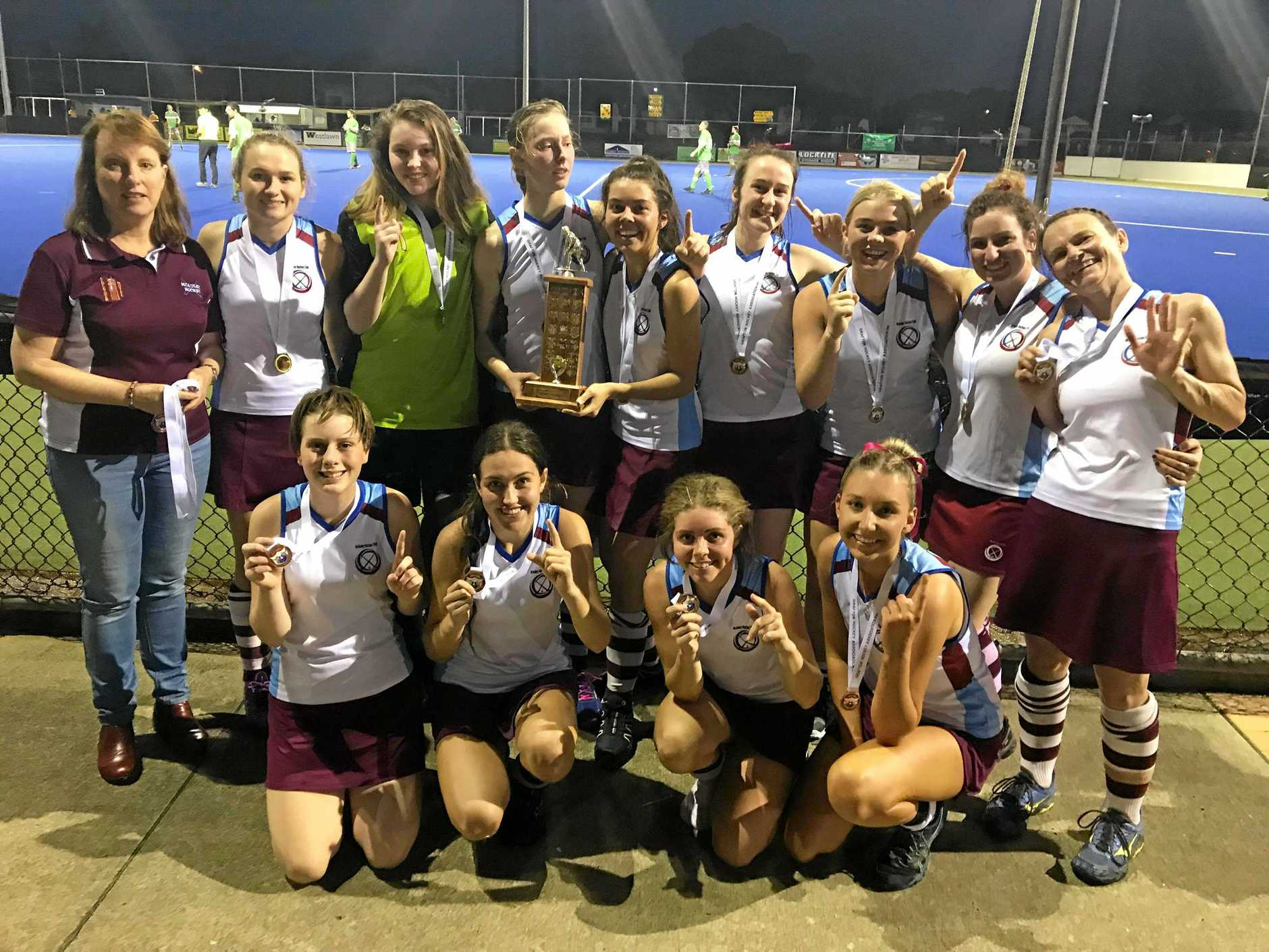 TOP TIER: McAuley White celebrates after taking out the Grafton Hockey Association womens first grade title.