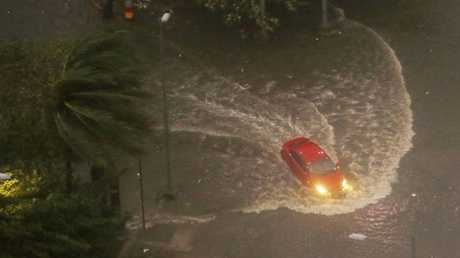 A vehicle negotiates a flooded street in Manila as Typhoon Mangkhut continues to batter northeastern Philippines before dawn Saturday, Sept. 15, 2018 in Manila, Philippines. Picture: Bullit Marquez.