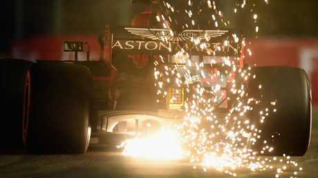 Sparks fly from Daniel Ricciardo's car on his way to qualifying sixth for the Singapore Grand Prix. Picture: Getty Images