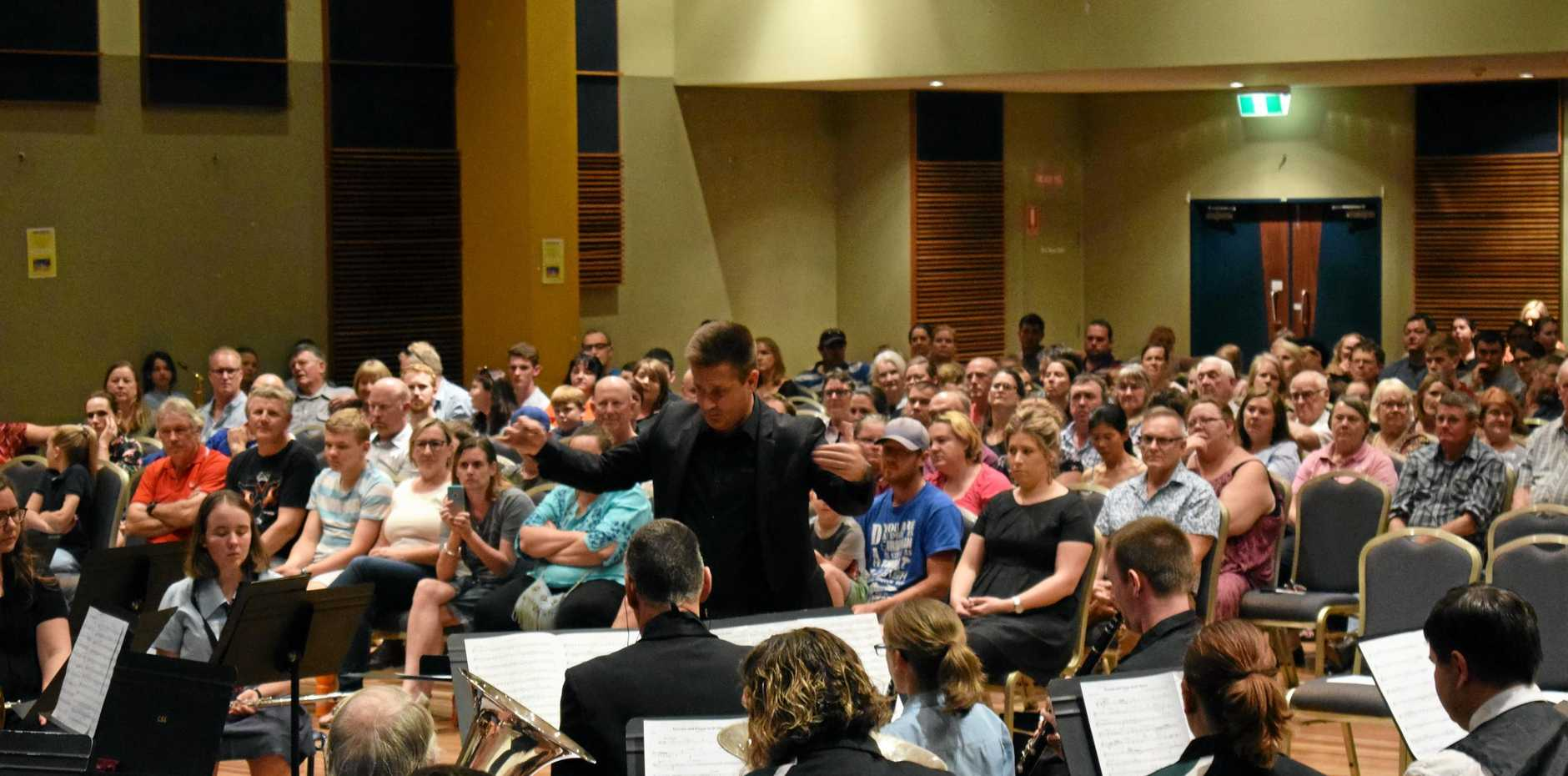 TASTE OF CULTURE: Community members perform with Queensland Symphony Orchestra musicians.