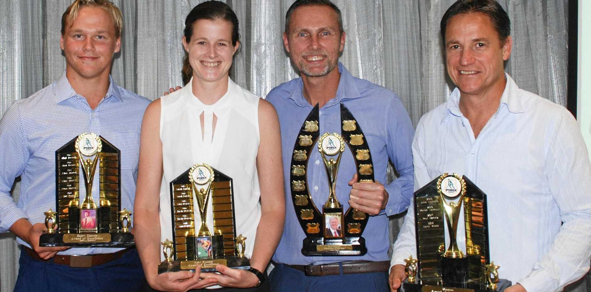 Ipswich Hockey's 2018 Masters award winner Terry Wode (right).