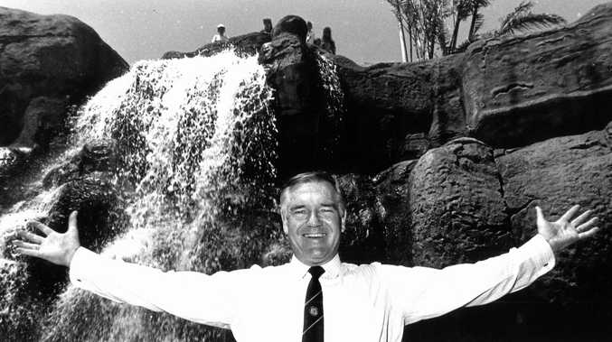 Former Rockhampton Mayor Jim Webber celebrates the re-opening of the Kershaw Gardens waterfall in 1990. It had to be rebuilt after collapsing the previous year.