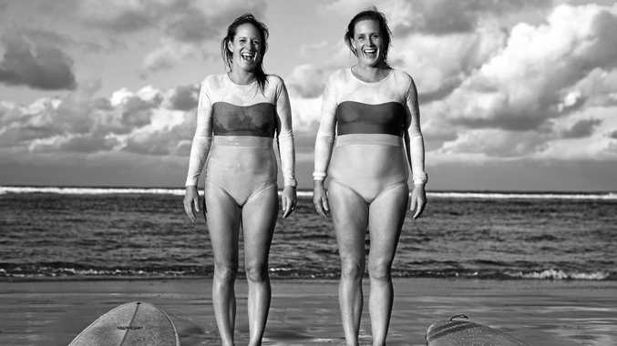 FAMILY: Twin Sisters Peta and Reg Grew surfing at the Boat Channel in Lennox Head. Photo Natalie Grono