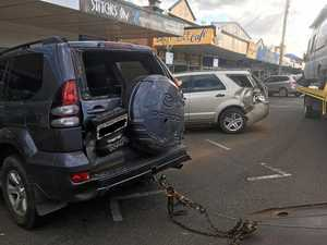 Vehicle crashes into parked cars