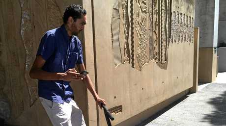 CANED: Nahum Christopher Binge, 24, departs Ipswich Courthouse aboard his scooter after a neighbours missing cane chairs were found at his Raceview home.