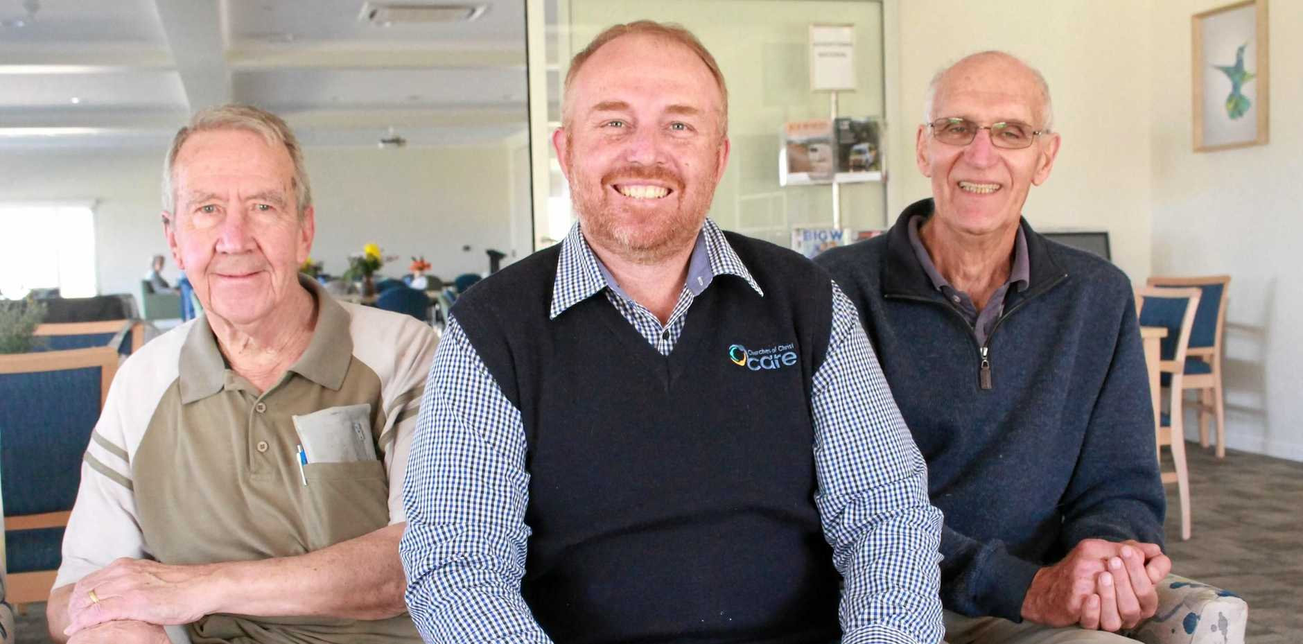 HAPPY HERE: Regency Park residents Graeme Parkinson, left, and Dudley Fitzgerald, right, enjoy the afternoon with manager Chris Newley, centre.