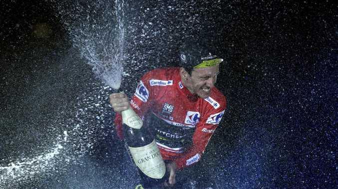 British rider Simon Yates of the Mitchelton-Scott team celebrates on the podium after winning the La Vuelta cycling race in Madrid, Spain, Sunday, Sept. 16, 2018. (AP Photo/Manu Fernandez)
