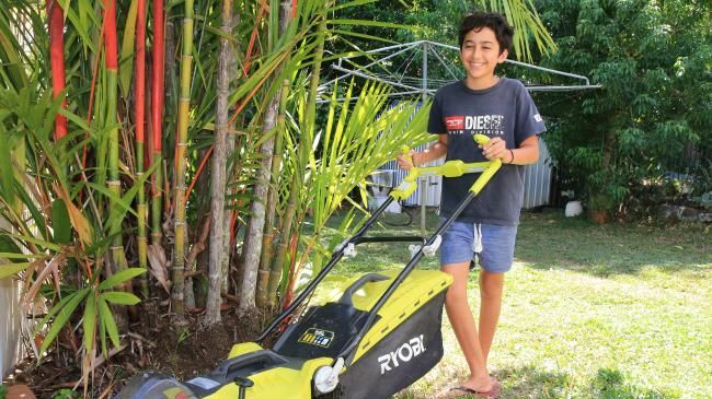 Sam Karyanto tries an electric lawnmower at Sustainable House Day, Freshwater. PICTURE: JUSTIN BRIERTY