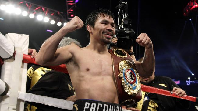 (FILES) This file photo taken on November 06, 2016 shows Boxer Manny Pacquiao of the Philippines celebrating after beating Jessie Vargas with a unanimous decision to win the WBO welterweight championship at the Thomas & Mack Center in Las Vegas, Nevada. WBO welterweight world champion Pacquiao said November 22 he felt like a young man in his twenties and would relish another crack at Floyd Ma