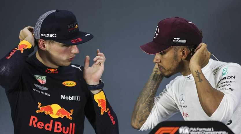 Red Bull driver Max Verstappen speaks to Mercedes driver Lewis Hamilton during a press conference. (AP Photo/Yong Teck Lim)