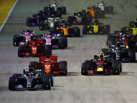 Lewis Hamilton leads Sebastian Vettel and Max Verstappen. (Photo by Mark Thompson/Getty Images)