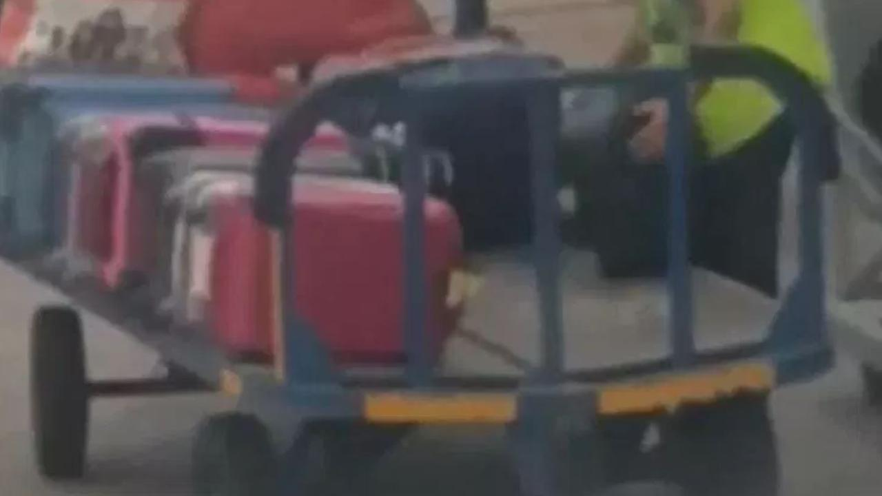 A passenger on a flight to Madrid filmed a baggage handler taking an item from a passenger's suitcase.