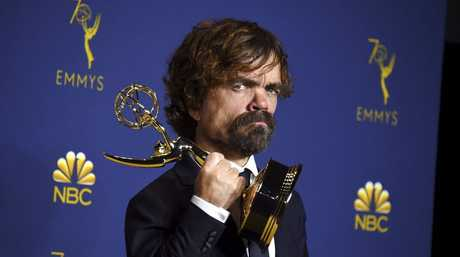Peter Dinklage poses in the press room with the award for outstanding supporting actor in a drama series for Game of Thrones at the 70th Primetime Emmy Awards in Los Angeles
