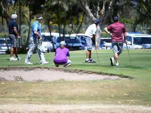 Golfers on the eighteenth green at the Friendlies