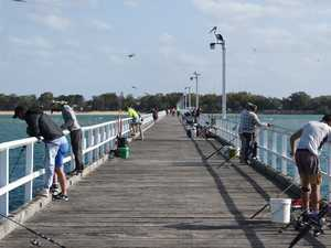 Urangan pier fishing - Fisherman at the end of