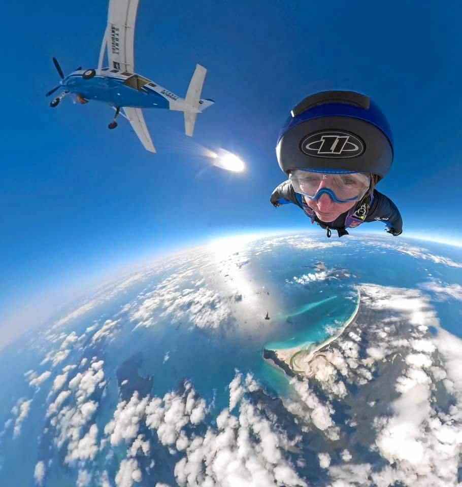 MID-FLIGHT: Steve Rose during his inaugural wing-suit flight over Whitehaven Beach.