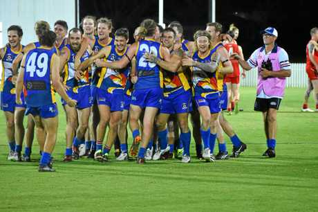 Whitsunday Sea Eagles players celebrate after the final siren.
