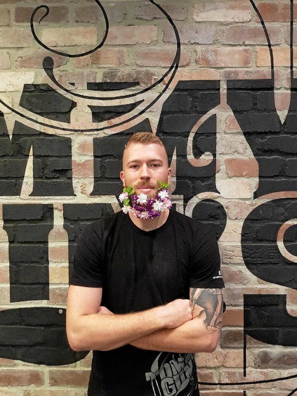 MAN UP: Dave Wilson models a Tommy Gun's flower beard.