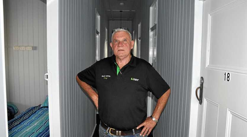 OPEN FOR BUSINESS: Monto publican Doug O'Sullivan admires the new-look Grand Hotel.