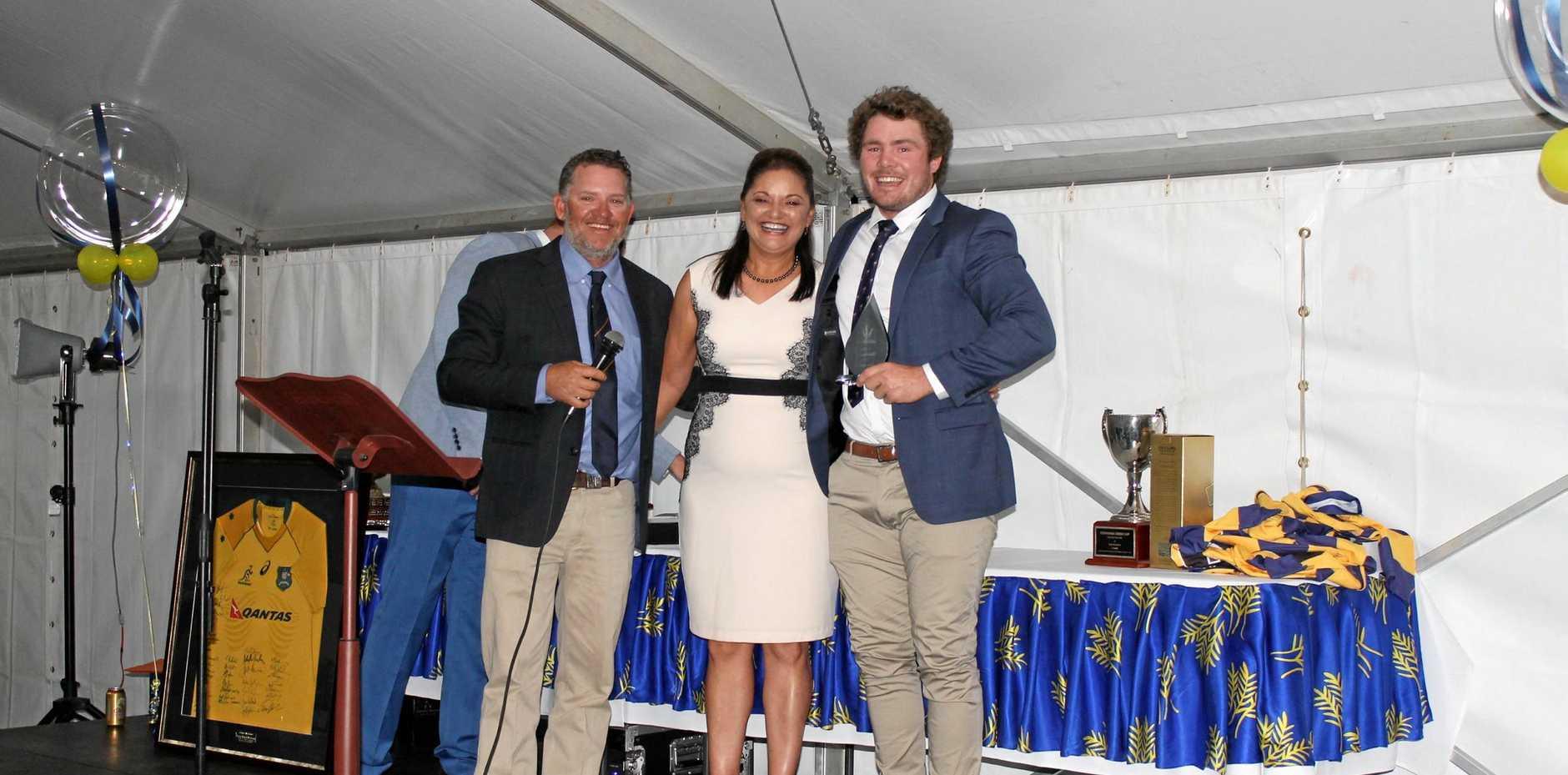 PRESENTATION: Windsor Hotel representative Michelle (centre) and Wheatmen coach Nathan Bradley present an award to Sam Hogarth.
