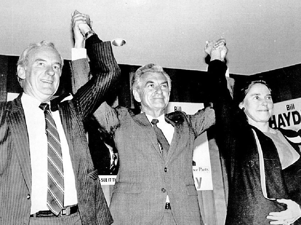 Prime minister Bob Hawke is flanked by Bill Hayden and his wife Dallas at Hayden's federal election campaign launch at Ipswich in 1987.
