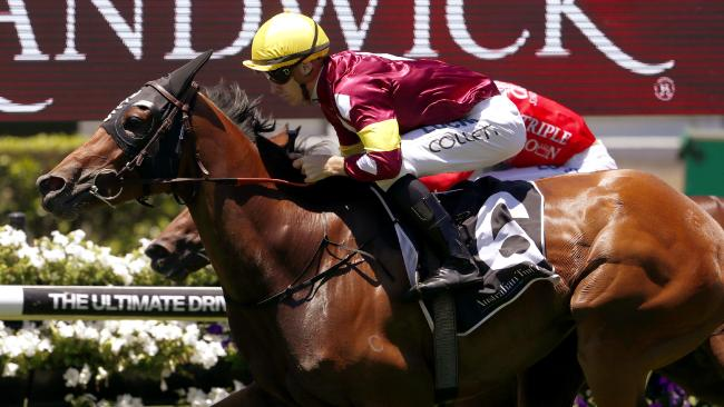 Jason Collet rides Aqua D'ivina to victory at Randwick. Picture: AAP
